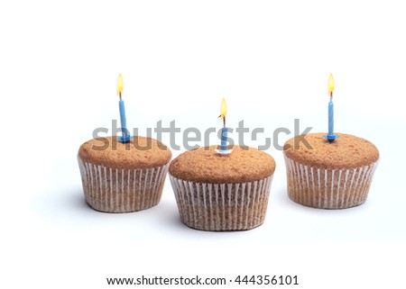 Three cupcakes on a wooden table