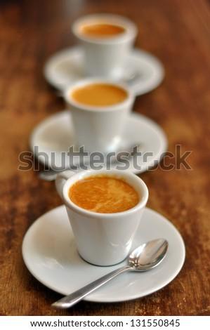 three cups of italian coffee expresso  - stock photo