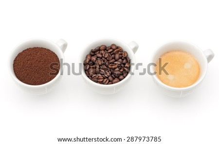 Three cups with coffee, beans and ground coffee - stock photo