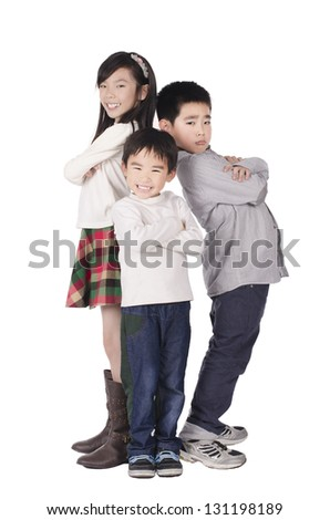 Three cute children posed over white background
