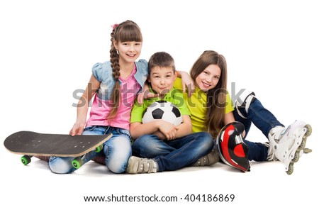 three cute children sitting on the floor with sport equipment