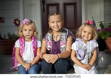 Three Cute Kids Ready to go to School - stock photo