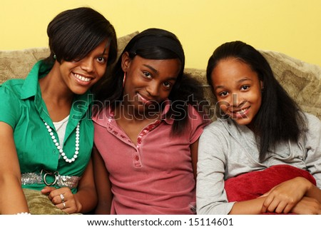 Three cute teenage sisters together - stock photo