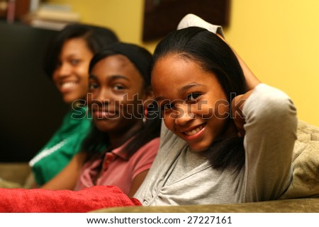 Three cute teenage sisters together. Shallow DOF. - stock photo