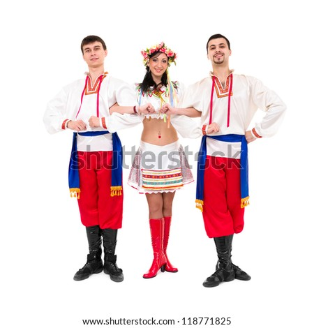 three dancers wearing a folk ukrainian costumes posing against isolated white background - stock photo