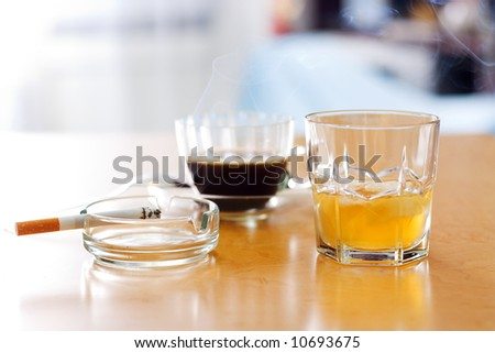 Three dangerous items: alcohol, coffee and cigarette (smoking) - stock photo
