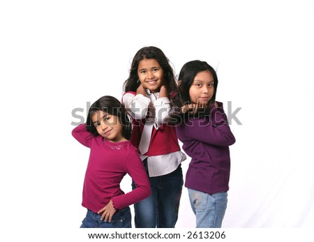 three dark hair young girls posing as models