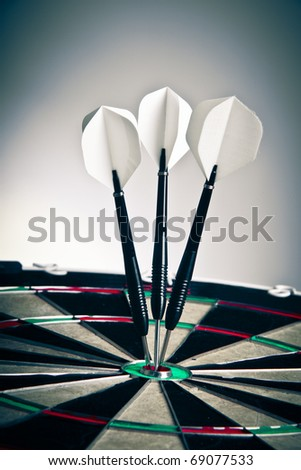 Three Darts Arrows Poked Right In The Center - stock photo
