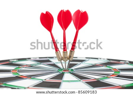 three darts hit the dead centre of target - stock photo