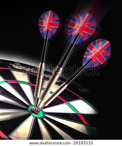 Three darts hitting bullseye on dart board - stock photo