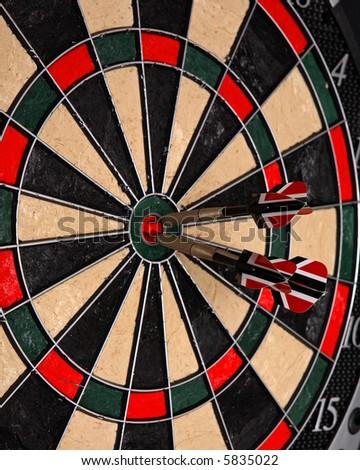 Three darts in a dartboard - stock photo