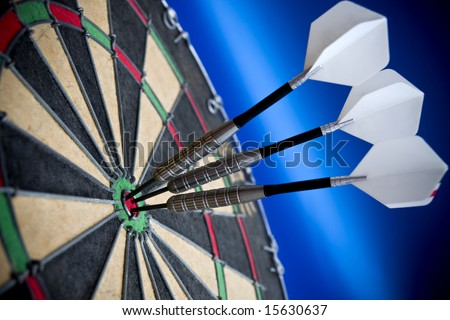 Three darts in the bulls eye - stock photo