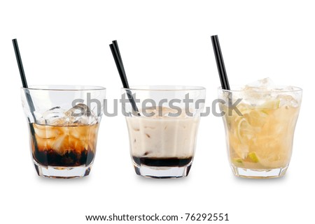 Three decorative cocktails on a white background. - stock photo