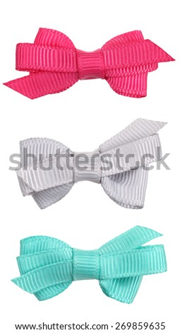 Three decorative ribbon bow ties pink gray turquoise blue - stock photo