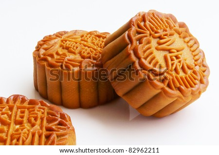 Three delicious moon cakes with white background - stock photo