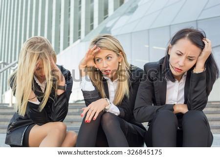 Three desperate business women  - stock photo