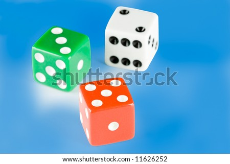 Three dice pieces on blue background, with clipping path