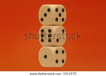 Three dices piled on top of each other showing all six numbers