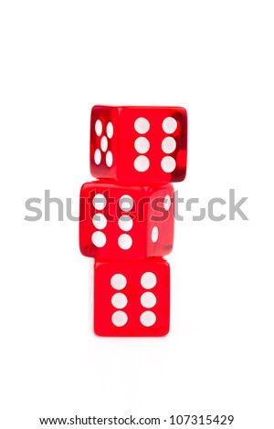 Three dices stacked against a white background - stock photo