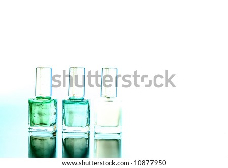 Three different bottle of nail polishes / copyspace / art - stock photo