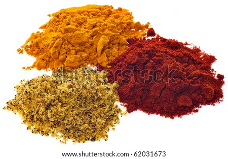 Three different brightly colored powdered spices on a white background - stock photo