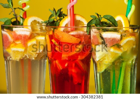 Three different cold drinks Fresh juice mix Three of fruit cocktails. Fruit cold tea cocktails. - stock photo