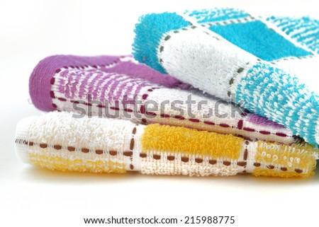 three different color towel isolated on white background - stock photo