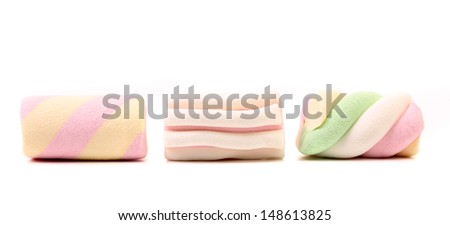 Three different colorful marshmallow. Close up. - stock photo