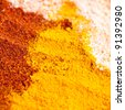 Three different  colorful powdered spices background - stock photo
