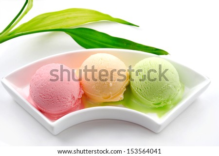 Three different colors flavors of ice cream - stock photo
