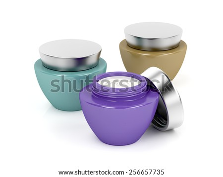 Three different cosmetic creams on white background - stock photo