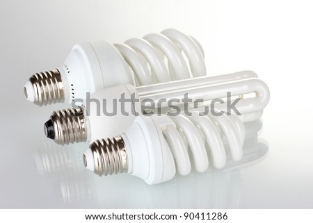 Three different energy saving lamp isolated on white - stock photo