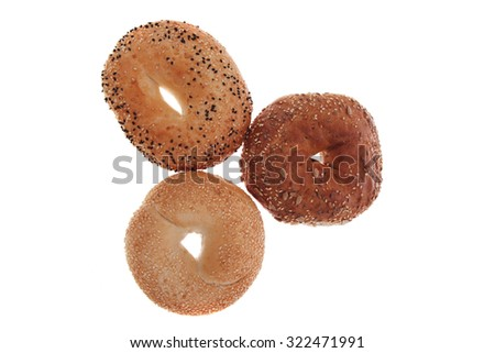 three different fresh bagels  isolated over white background - stock photo