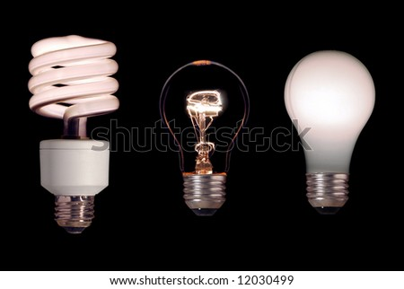 Three different light bulbs on a black background. - stock photo