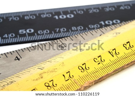 Three different measurement rulers isolated on white background. - stock photo