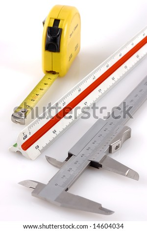 Three different measuring tools on a white background - stock photo