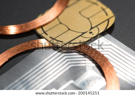three different RFID Antenna copper coil etched antenna UHF contact chips processor - stock photo