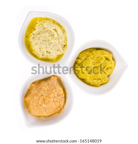 three different sauces in a white bowl different colors isolated on white background - stock photo