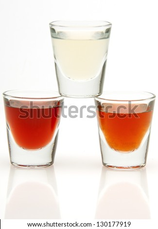 three different shot drinks isolated on white background
