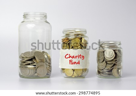 Three different size of jars with Charity fund text - Financial Concept