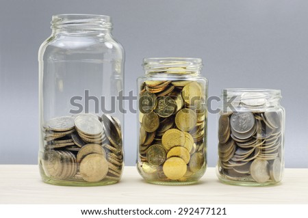 Three different size of jars with coins - Financial Concept - stock photo