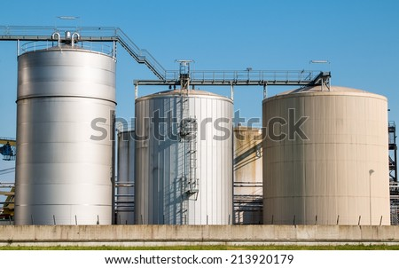 Three different size silos clean construction on clear sky healthy food supply unit wide angle, clean master shot. - stock photo