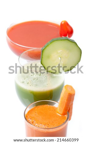 three different smoothies with tomato, cucumber and carrot, close-up, white background, isolated, portrait format