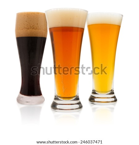 three different varieties of beer on white background with reflections - stock photo