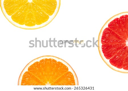 Three different varieties of orange slice arranged around the frame displaying halves showing the segments and traditional orange fruit and red flesh of the blood orange on white with copyspace.  - stock photo