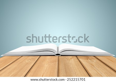 Three-dimensional illustration of white blank open book on wooden planks - stock photo