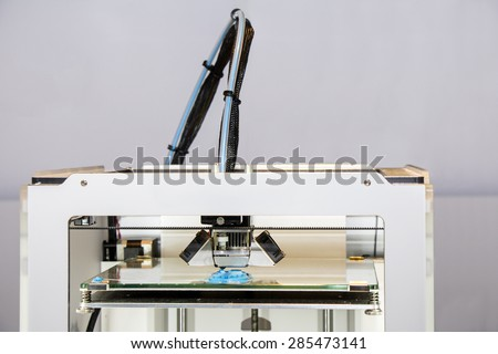 Three dimensional printer, Printing with blue Plastic Wire - stock photo