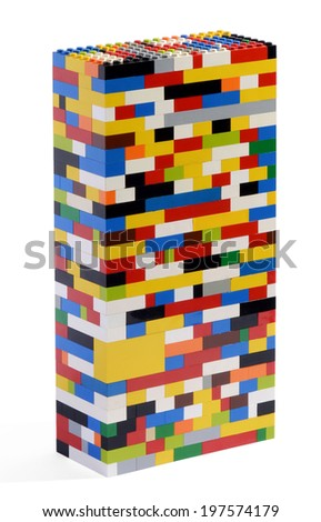 Three dimensional rectangular tower constructed of colorful plastic bricks which can be assembled and disassembled into numerous shapes isolated on white - stock photo