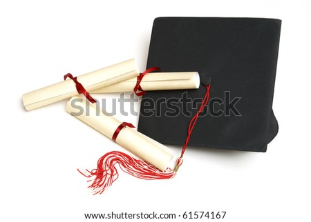 Three diploma certificates alongside a grad hat to celebrate the students success. - stock photo