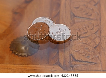 three dirham coins on table - stock photo